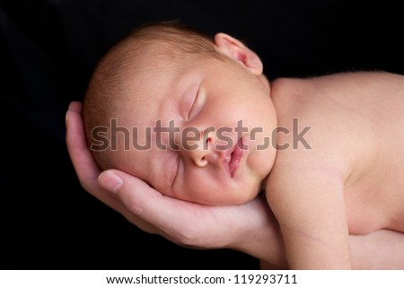 A beautiful newborn baby girl in mother's hands