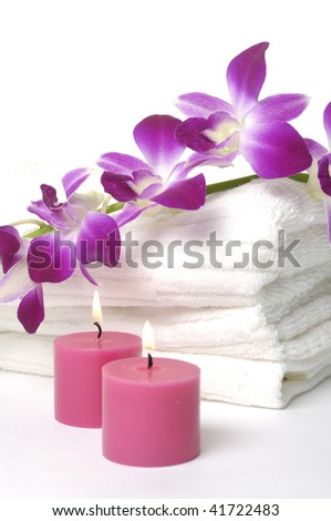 A beautiful orchid, towel and candles - stock photo