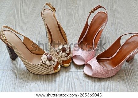 A Beautiful woman shoes on the floor - stock photo