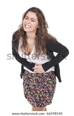 a beautiful woman suffering with pain in her belly - stock photo