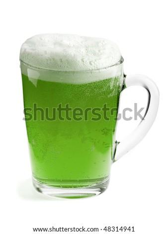 A beer mug of green beer - stock photo