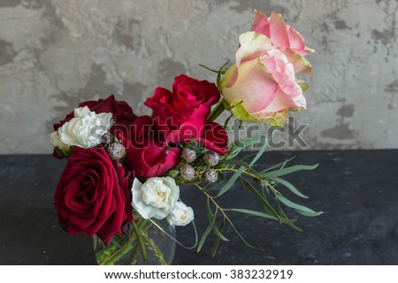 A bouquet of flowers of roses, carnations and other flowers.Copyspace  - stock photo