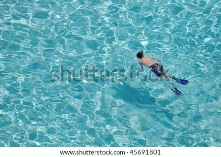 a boy snorkelling in outdoor swimming pool