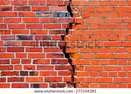 A brick wall with a crack - stock photo