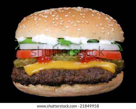a cheese burger loaded with summer garden vegetables - stock photo