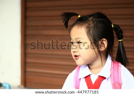 A child's eyes Asian love. Portrait of a cute Asian child girl and Eat sticky rice with pork.