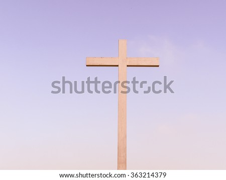 A Cross over a blue sky background vintage