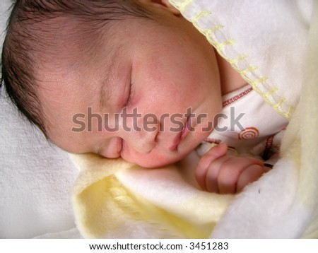 a dark haired one day old baby peacefully sleeping - stock photo