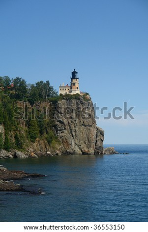 A distance picture of split rock lighthouse on Lake Superior
