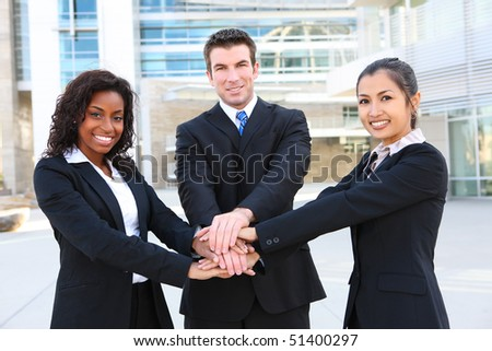 A diverse attractive man and woman business team at office building (Focus on Man) - stock photo
