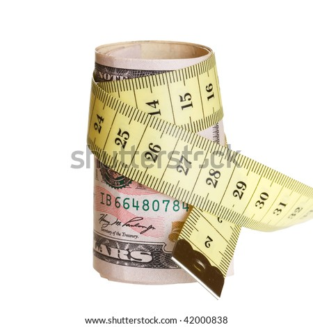 A dollars  with a tape measure wrapped around. - stock photo