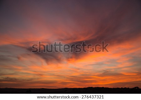 A fiery sky at sunset in Ayamonte, Andalucia, Spain  - stock photo