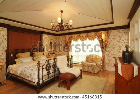 A finished bedroom with classic decoration.