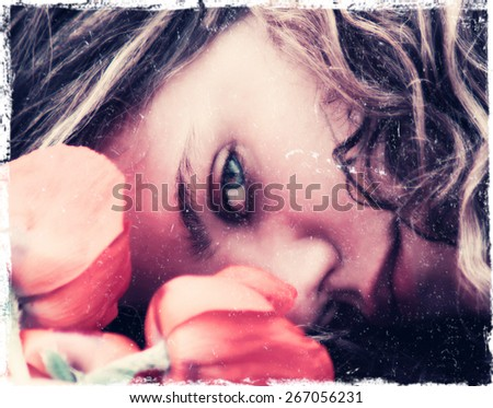 a girl resting her head on a table with flowers toned with a retro vintage instagram filter effect app or action - stock photo