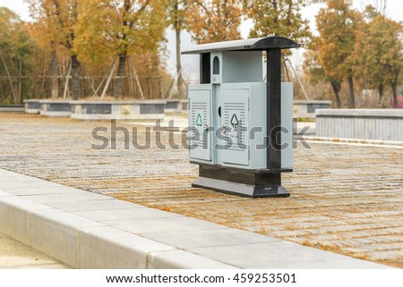 A group of Garbage cans on the side of the road;  - stock photo