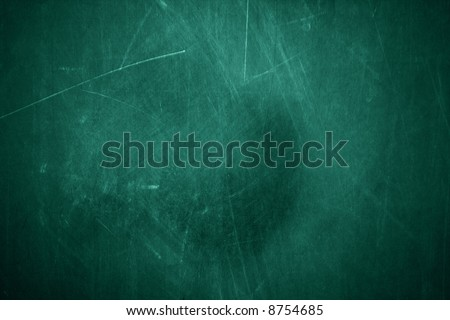 A grunge textured type of chalkboard background. - stock photo