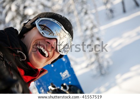 A health lifestyle image of young snowboarder
