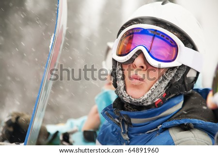 A health lifestyle image of young snowboarder - stock photo
