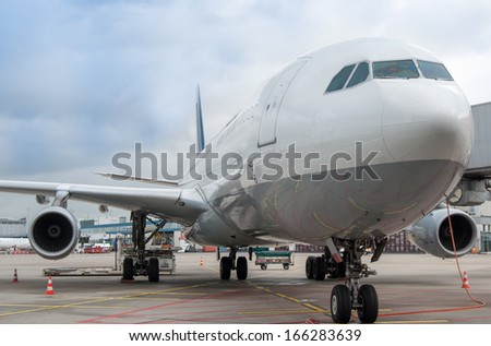 A340-300 is being preparing for a flight - stock photo