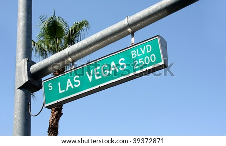 A Las Vegas Blvd street sign hanging from a pole - stock photo