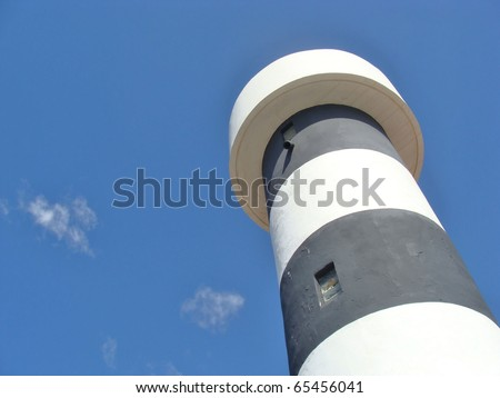 A lighthouse on the island of Mallorca in Europe from the worm`s-eye view
