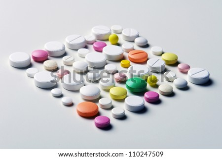A lot of different medicaments arranged to square as mackground - stock photo