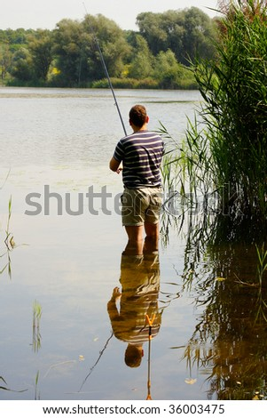 A man fly-fishing in Pogoria - Poland