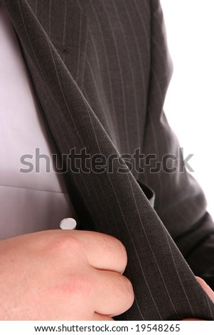 A man removing a pen from his inside pocket - stock photo