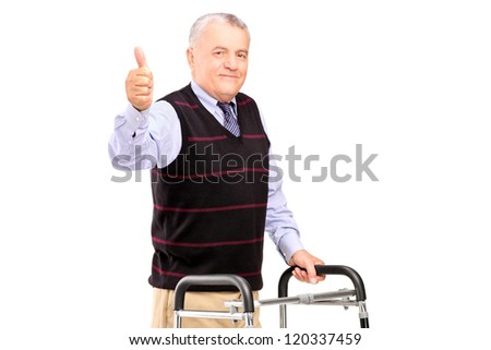A mature gentleman using a walker and giving a thumb up isolated on white background - stock photo