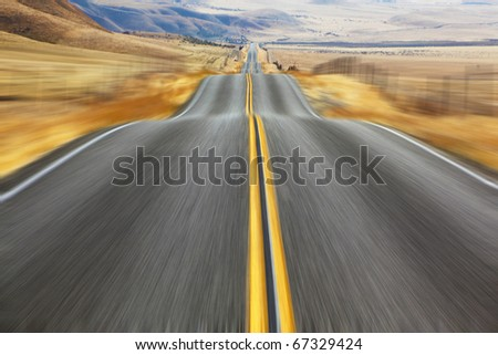 A Mirage on high speed. Magnificent American road and fencings on roadsides from snow drifts - stock photo