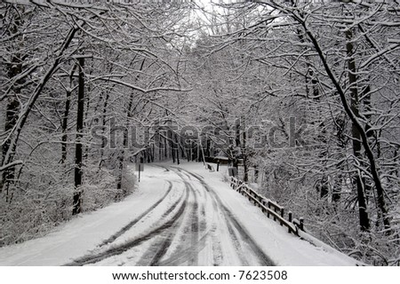 a picture of a snow covered road after a winter storm in indiana