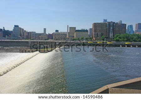 A picture of Minneapolis skyline across from dam