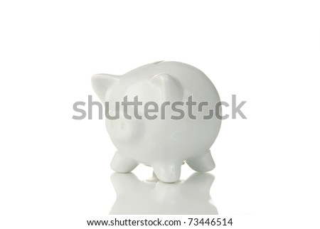 A piggy bank reflecting on a white background