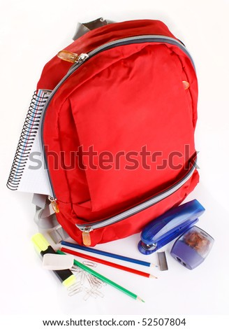 A red school backpack with school supplies - stock photo