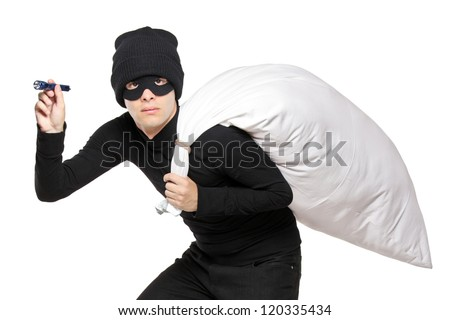 A robber with a bag on his back and flashlight isolated on white background