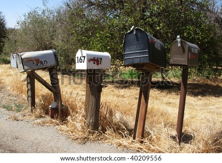 A row of mail boxes in a rural community. USA. - stock photo