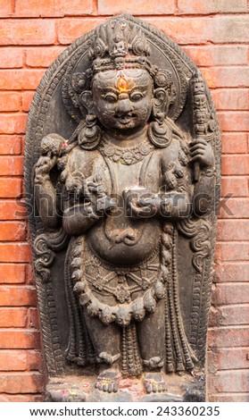 A sculpture of a Buddhist god in Svayambhunath, Nepal - stock photo