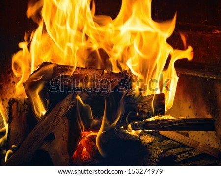 A small fire in the fireplace to smoke