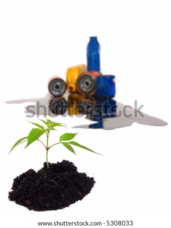 A small seedling sprouts from a pile of clean soil....but for how long? - stock photo