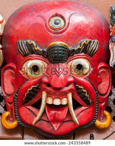 A traditional Buddhist demon mask in Swayambhunath, Nepal  - stock photo