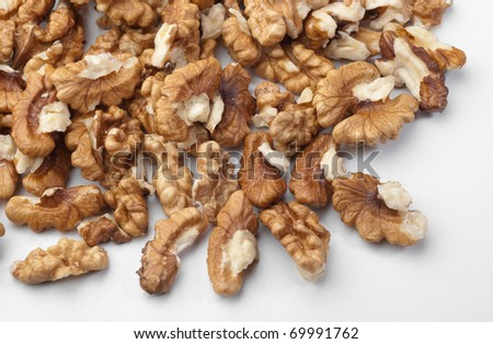 A very large layer of walnut pieces. - stock photo