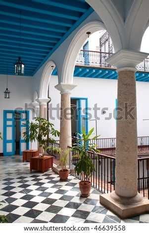 A view of colonial building interior with tropical flowers, Old Havana , Cuba - stock photo