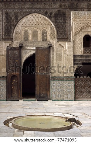 A view of the medieval Moroccan madrasa (madersa) in the imperial city of Fez. - stock photo