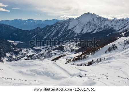 A view of the small village of Mandriou, Valle d'Aosta, Italy, as seen on the way back from Monte Facciabella. The small church located at Alpe Vascoccia dominate the valley and the small ski area. - stock photo