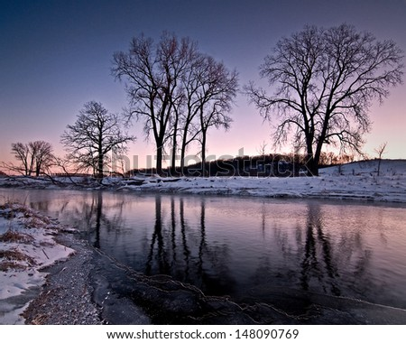 A winter sunrise on Nippersink Creek in Glacial Park Conservation Area, McHenry County, Illinois. - stock photo