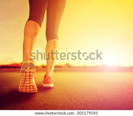 a woman with an athletic pair of legs going for a jog or run du - stock photo