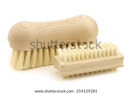 a wooden nail brush and a wooden household brush on a white background - stock photo