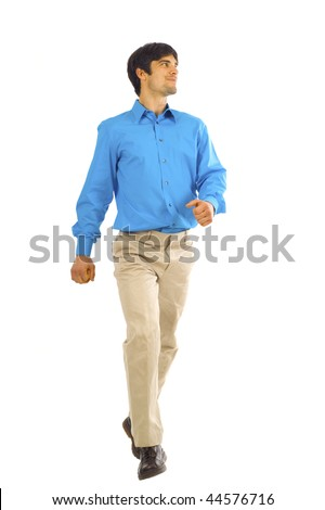 A young businessman is walking. He is smiling and looking away from the camera isolated over white background