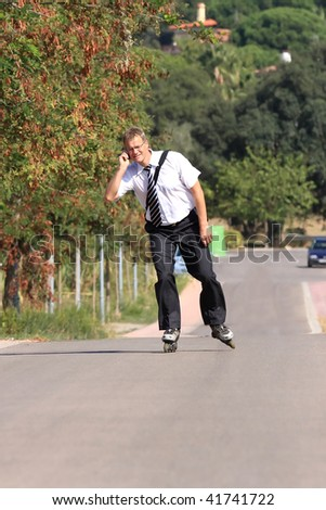 A young businessman with a roller skate - stock photo