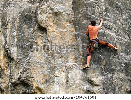 A young climber on the wall. - stock photo